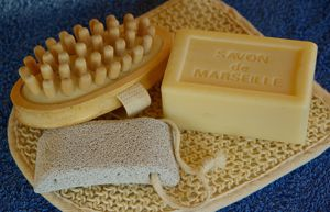 Exfoliate feet with pumice stone